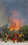 Western states' fire season piles anxiety upon misery