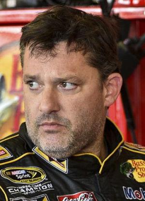 Allmendinger wins race; Stewart sits out after death