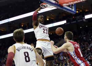 James hits 25K as Cavaliers beat McConnell, 76ers