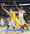NCAA championship game notes: Backup Albrecht delivers 1st-half spike to Michigan