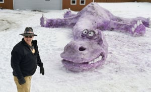 Photo of the day: Dinosaur snow sculpture