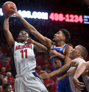 Arizona-UCLA postgame: On McKale crowd, Allen's illness and Trier's bare hand