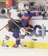Sharks prey on backup goalie to stun Rangers