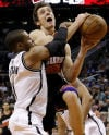 NBA Nets hold off late Suns rally