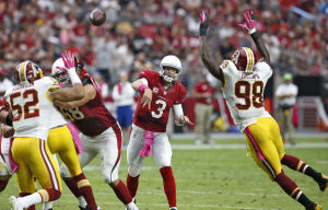 Palmer returns, sparks Cardinals in win