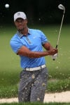 Golf: Tiger ties career best with 61