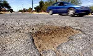 Road Runner: Pima County budget tight for pothole repairs