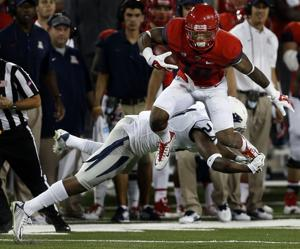 UA football: Cats escape with 35-28 win over Nevada