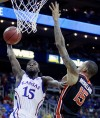 College basketball: Kansas holds on vs. OSU