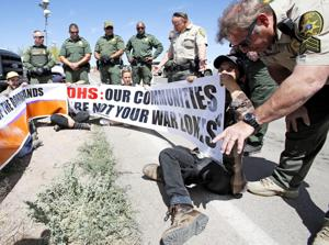 Protesters push for closure of Amado border checkpoint