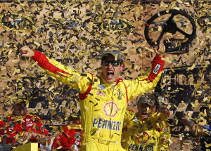 Logano captures checkered flag in Kansas