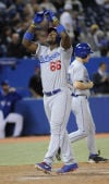 Game of the day: Dodgers 8, Blue Jays 3: Ellis, Puig lead Dodgers' latest comeback victory
