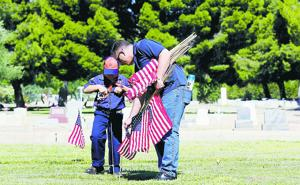 Old Glory adorns veterans' graves at Evergreen cemetery