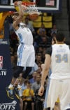 NBA playoffs Nuggets hold off Warriors, stay alive