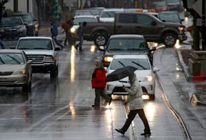 Three weather systems bringing rain, snow