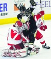 Penguins use muscle, hustle in home win
