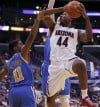 Pac-12 tournament Arizona 66, UCLA 58 Hanging on at Staples