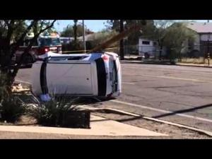 Rollover closes Grant Road from 4th Ave. to Los Altos