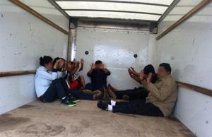 9 migrants found in moving truck near Tucson