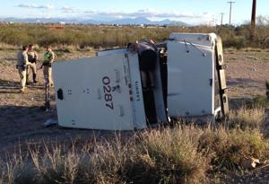 Armored truck rolls at I-10 and Kino