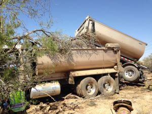 Driver crashes tandem dump truck NW of Tucson
