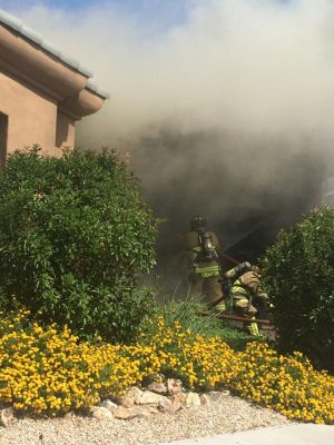 Green Valley firefighter slightly injured at house fire