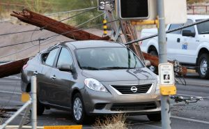 Storm closes major west-side intersection; 13,000 without power