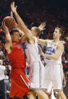 Pac-12 basketball tournament No. 21 UCLA 66, No. 18 Arizona 64 Bruins school Cats 3rd time