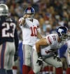 NFC East: Flip a coin or bet on Eli? We pick Manning