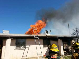 Photos: Crews respond to fire at a triplex