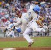 College World Series Bruins survive, take series lead