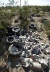 Illegal dumping littering area with tons of trash