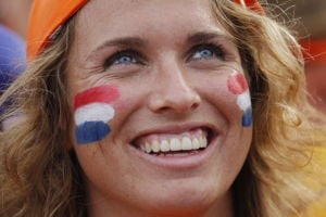 Ord: Dutch fans bring glowing smiles, orange gear to World Cup