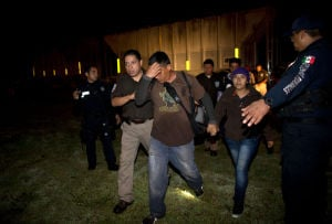 Agents pulling migrants from southern Mexico rail cars