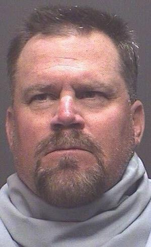 UA track coach accused of threatening student resigns