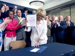 Brewer signs Medicaid expansion law