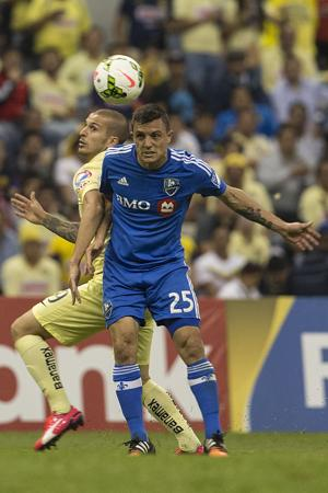 Toia helps Montreal earn draw in first leg of final