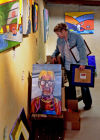 Friends, family help open, carry on late artist's show