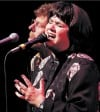 Linda Ronstadt praises Moore in Vegas, is ejected