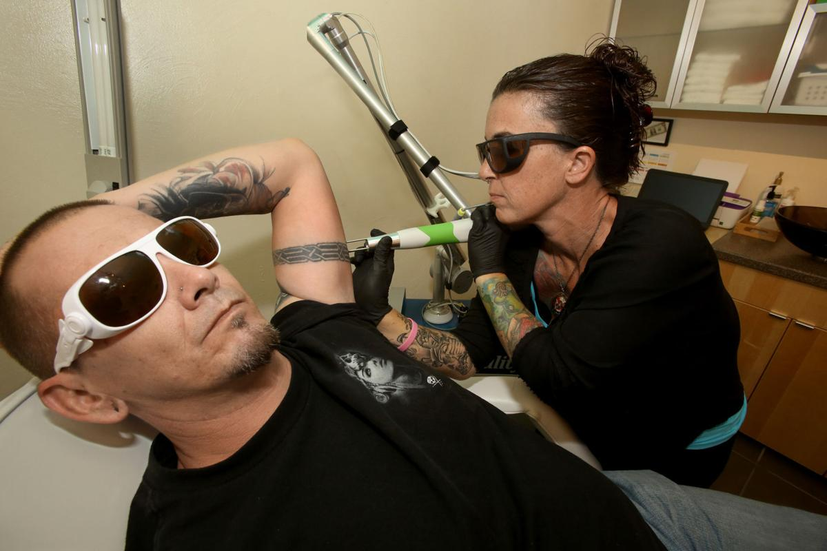Tucson couple makes their mark on tattoo scene as artist for Tattoo removal business