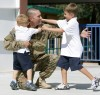 Military duty pauses for welcome-back hugs