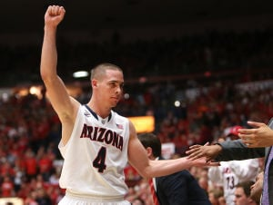 Photos: No. 3 Arizona 87, California 59