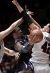 No. 9 Arizona 68, Utah 64 Cats squeeze through
