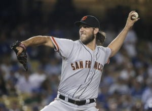 NL wild card: Bumgarner's bat makes lefty dual threat