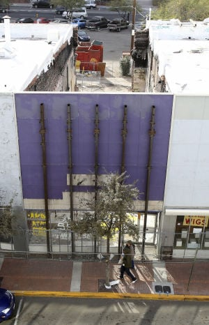 "Repair work starts on burned-out ""Wig-O-Rama"" building downtown"