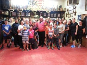 Boxing trainer earns bell for helping kids