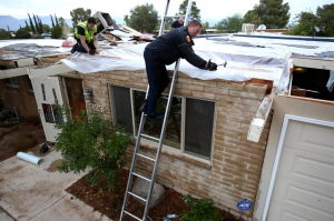 Storms trap 2 in Tucson wash, knock power out