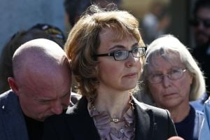 Giffords at Tucson shooting site: Expand gun-buyer background checks