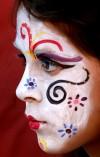 Floats, masks, face paint honor the dead