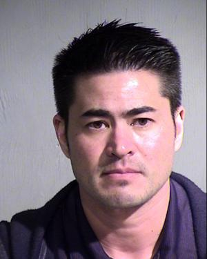Arizona 'pregnant man' charged with stalking wife